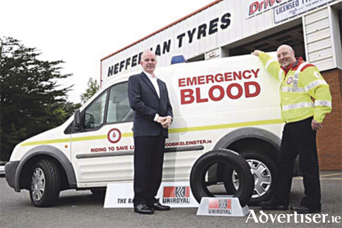 Tom Dennigan of Uniroyal Tyres Ireland with Fergus Lennon of Blood Bike Leinster and the charity's support vehicle newly fitted with Uniroyal Tyres
