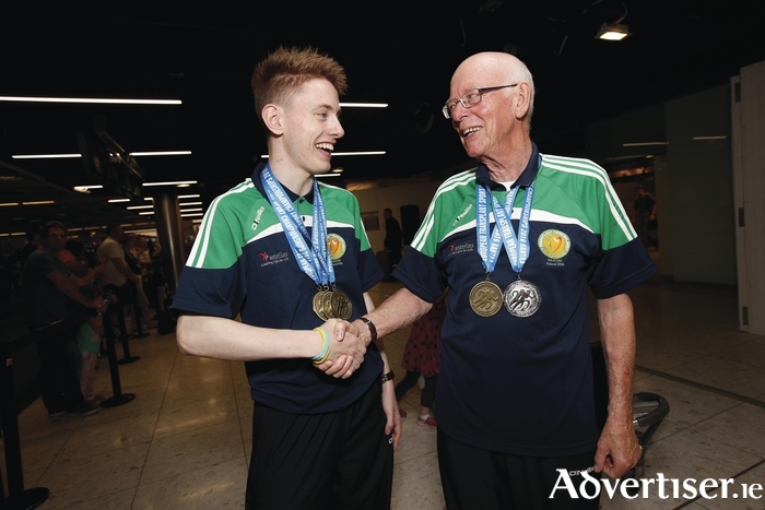 Transplant Team Ireland's youngest member Matthew McNeive (age 18) from Knock congratulating oldest team member Jon McAleer (age 78) from Antrim, both kidney transplant recipients. Photo: Conor McCabe Photography.