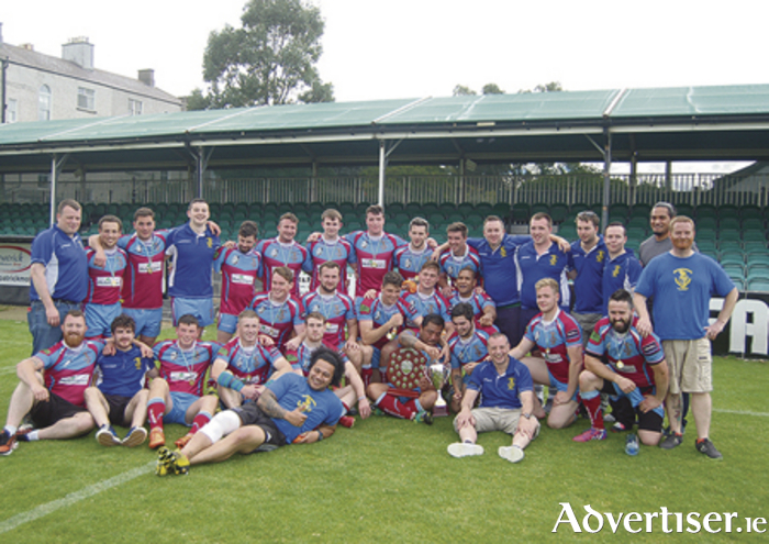 Galway Tribesmen celebrate winning the All Ireland Rugby League Championship crown.