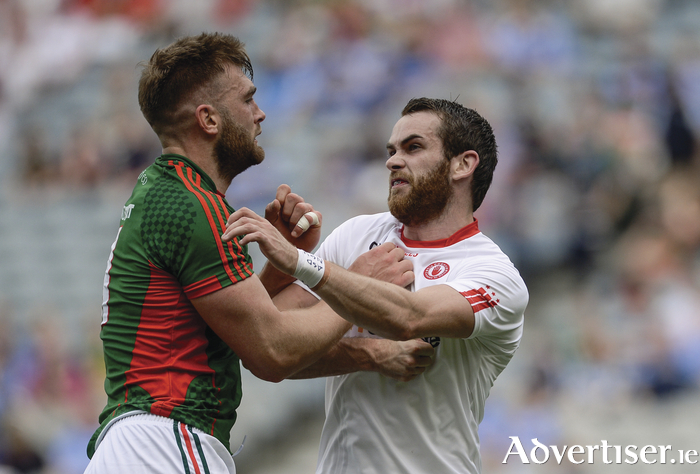 Standing tall: Aidan O'Shea stands his ground against Ronan McNamee in Croke Park. Photo: Sportsfile