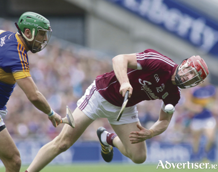 Galway's Joe Canning and Tipperary's James Barry in action from the at the  GAA Hurling All - Ireland semi-final at Croke Park on Sunday. Photo:-Mike Shaughnessy