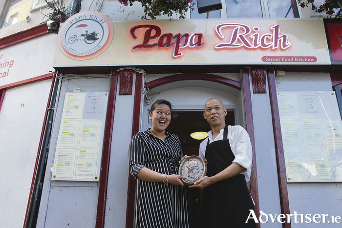 Husband and wife team Rebecca and Kevin Tan proudly display a coveted Gold Standard Restaurant plaque outside their Woodquay premises. Their hugely popular restaurant Papa Rich Asian Streetfood Kitchen may have been open for less than a year, but it has already been recognised as being among the best restaurants in Ireland. The award from RestaurantsIreland recognises excellent service in the hospitality field.