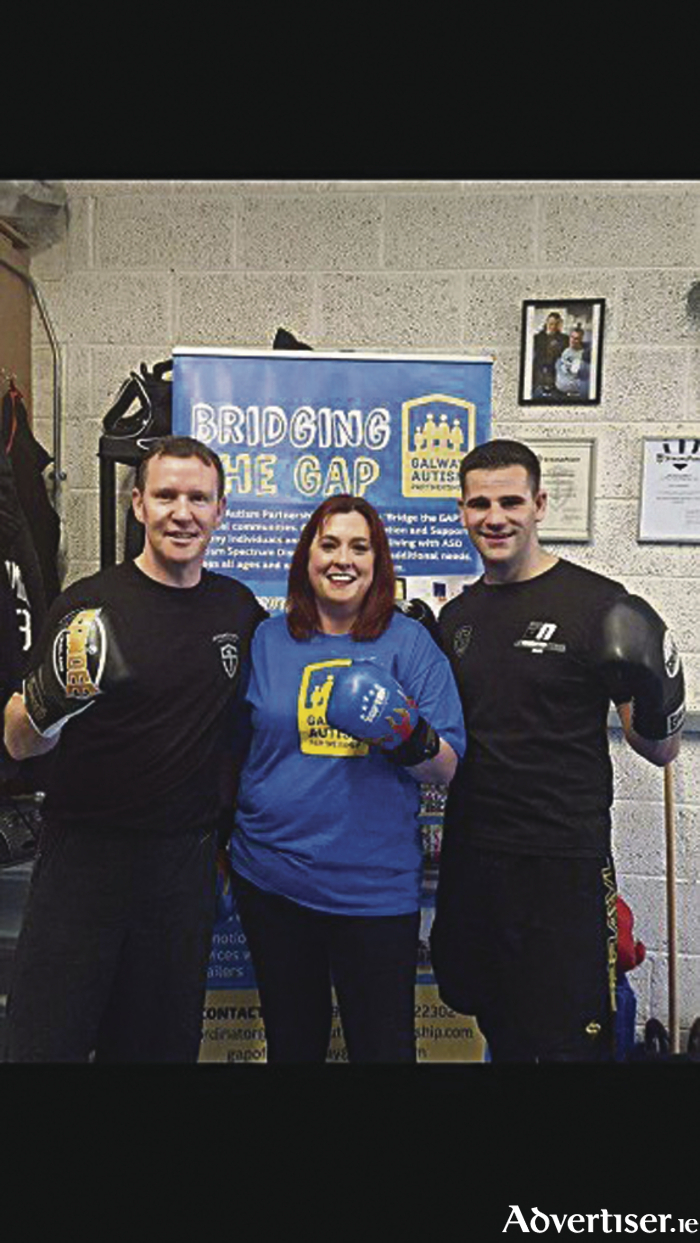 Sheila Coen (GAP), Don Naughton of Don Naughton Fitness, and Alan Donnellan (team boxer) launching GAP's third annual white collar boxing event.