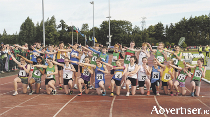 U14 girls and boys hurdlers pose in a tribute to Olympic hero Usain Bolt during the second weekend of the Community Games National Festival at Athlone IT. Photo: Seb Daly/Sportsfile