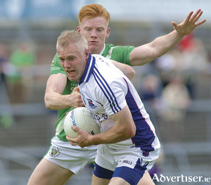 Caherlisteranes Shane Bohan comes under pressure from Moycullens Peadar Ó Cuig in action form the Galway County Senior Football Championship game at Pearse stadium on Sunday. Photo:-Mike Shaughnessy