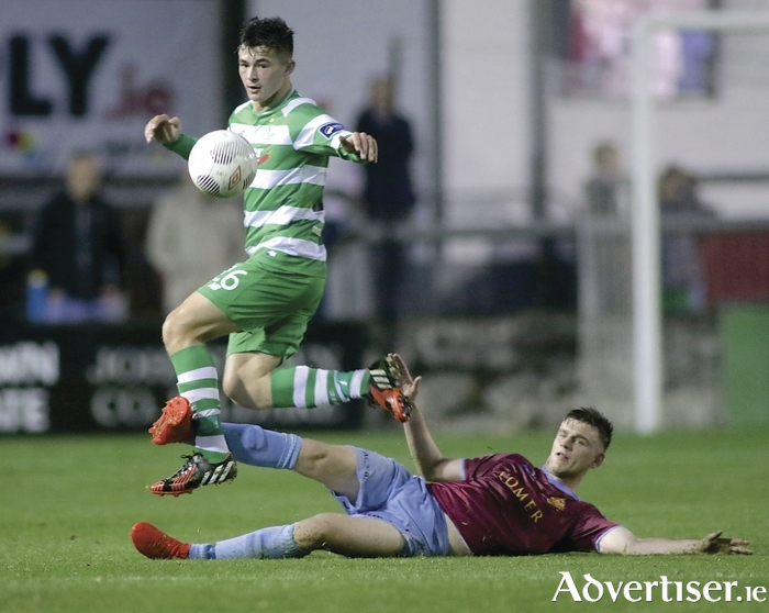 Galway United's Kilian Cantwell makes a successful challenge on Shamrock Rovers Aaron Dobbs in action from the SSE Airtricity League game in Eamonn Deacy Park on Tuesday night. 					Photo:-Mike Shaughnessy