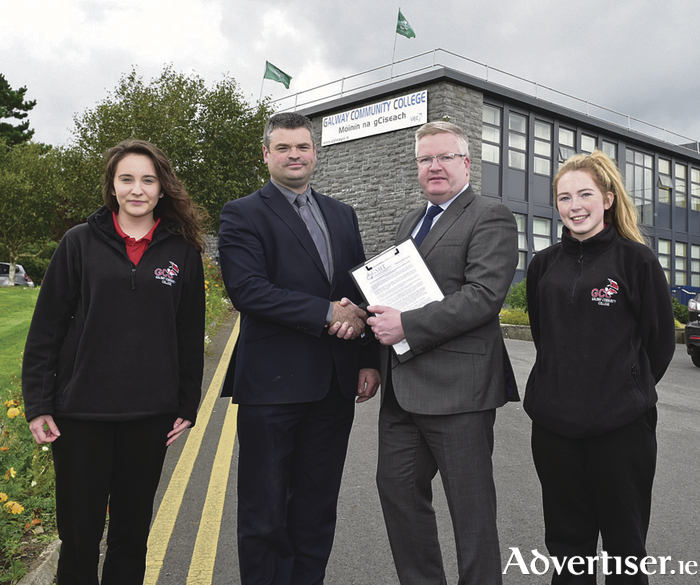 Pictured after the signing are L to R: Brian Melia, Principal of GCC (left) and Dr Fergal Barry, President of GMIT, with fifth year GCC students Wiktoria Gorczyca (left), Headford Road, and Alanna O'Reilly, Ballybane. [Photo by Joe Travers.