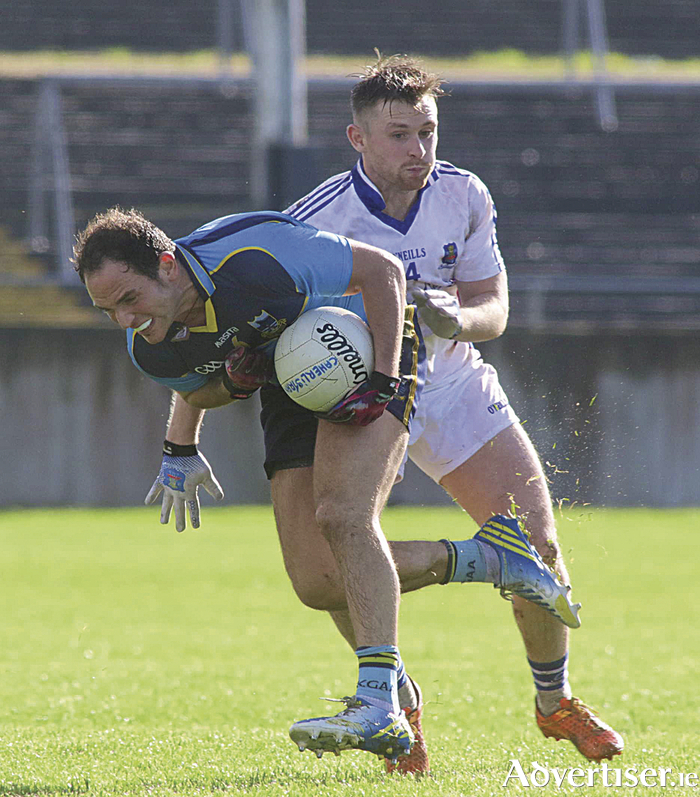 Salthill Knocknacarra's Ruaidhrí McTiernan and Catherlsitrane's Colm Monahan in action from the senior championship game at Tuam Stadium on Sunday.  		Photo:-Mike Shaughnessy