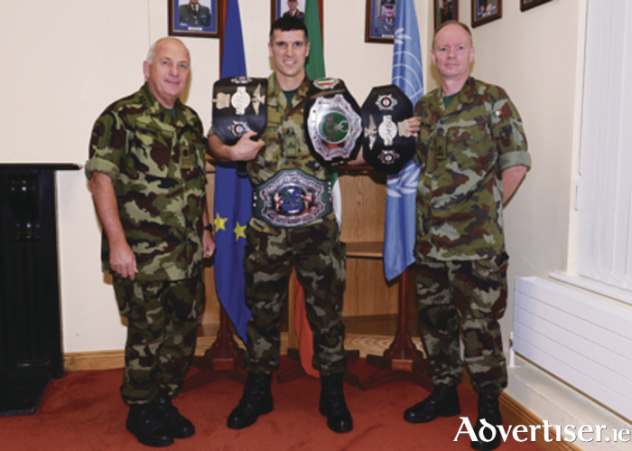 Martin Ward is pictured with his four Irish titles alongside CS PJ Higgins and Lt Col Golling