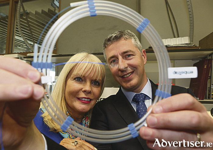 Ireland's position as one of the top medtech clusters in the world was bolstered by the official launch of CÚRAM, the Centre for Research in Medical Devices. CÚRAM is a Science Foundation Ireland Research Centre based at NUI Galway. Pictured at the launch were Minister for Jobs, Enterprise and Innovation, Mary Mitchell O'Connor with Michael Gilvarry of Neuravi  which is working on a project to better understand the properties of blood clots in order to develop the next generation of devices that can quickly remove them, thus minimizing the impact on patients.   Photograph by Aengus McMahon