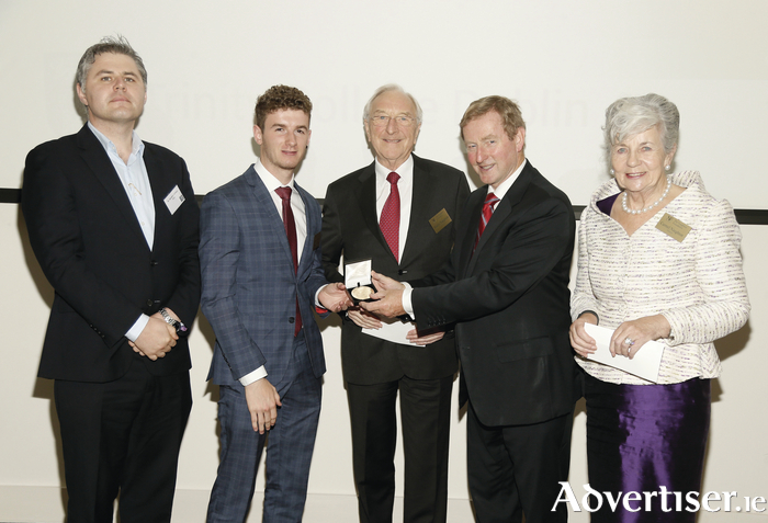 St Gerald's College, Castlebar, principal Daniel Hyland and Mayo scholar Donal Boyle with Dr Martin Naughton, An Taoiseach Enda Kenny, and Carmel Naughton at the 2016 Naughton Foundation Scholarship awards held at Trinity Biomedical Sciences Institute, Trinity College Dublin. Photo: Kieran Harnett.