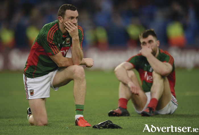 "Hard to take: Keith Higgins and Seamus O'Shea wonder what might have been at full time. Photo"":"