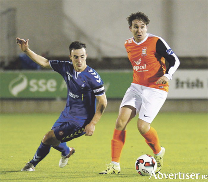 Roy King gets away from Limerick captain Shane Tracy