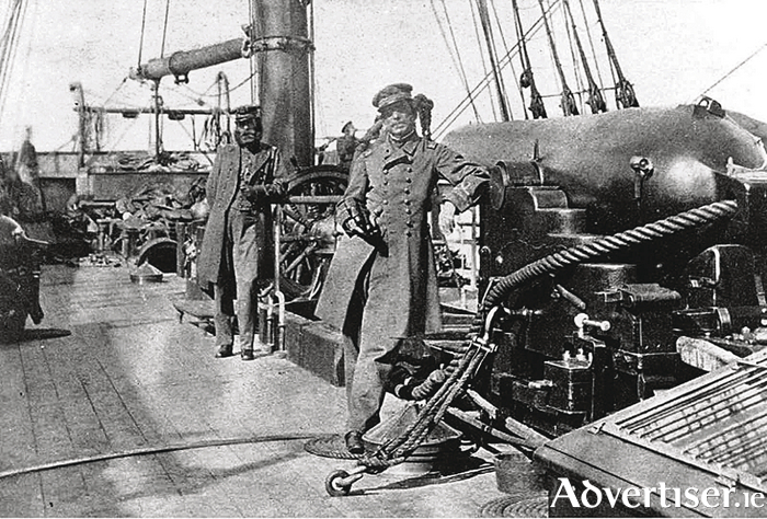Captain Raphael Semmes, Alabama's commanding officer, standing by his ship's 8-inch bore gun, which brought havoc to the Union navy.
