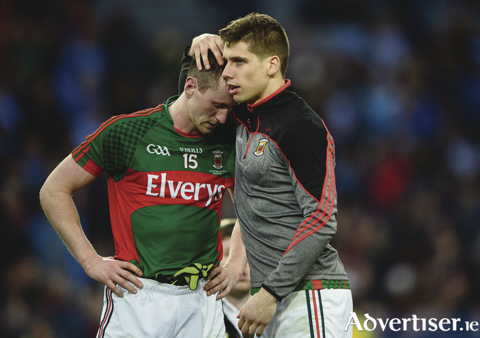 Cillian O'Connor of Mayo, left, is consoled by team-mate Lee Keegan after the GAA Football All-Ireland Senior Championship Final Replay match between Dublin and Mayo at Croke Park in Dublin. Photo Sportsfile