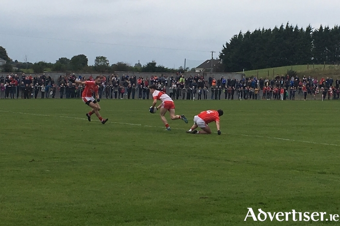 Ballintubber saw off the challenge of Aghamore to top their group this evening in Tooreen.