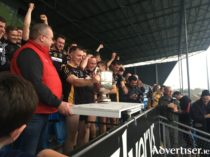 Champions time: Louisburgh captain Kevin Gibbons gets ready to lift the McDonnell Cup.