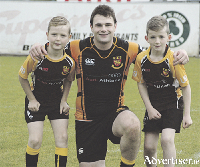 Mascots James Kelly and Rory Dolan are pictured with Buccaneers captain Shane Layden prior to the game against UCC