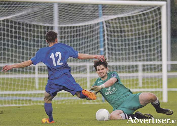 Athlone Town goalkeeper Dylan Owens saves at the feet of Jake Mooney.  Photo: Ashley Cahill/AC Sports Images