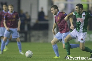 Galway United's Vinny Faherty and Cork City's Alan Bennett in action from the SEE Airtricity League game at Eamonn Deacy Park on Saturday. Photo:-Mike Shaughnessy