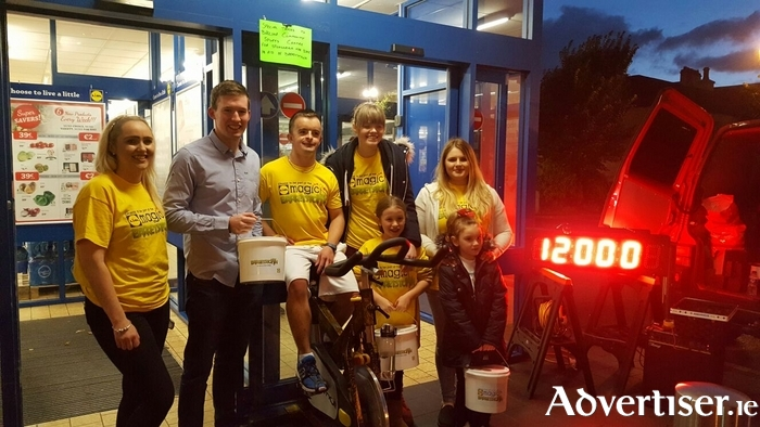 Lidil Store Manager Hugh Hester and Barrestown Buddy Lee Barrett on the 12th hour of their Barretstown Spinathon with Lidl staff at Lidl (Bury Street).  A special thanks to all of their loyal customers who helped us raise a fantastic €1,400 and the Ballina Community Sports Centre for loan of the spin bike.