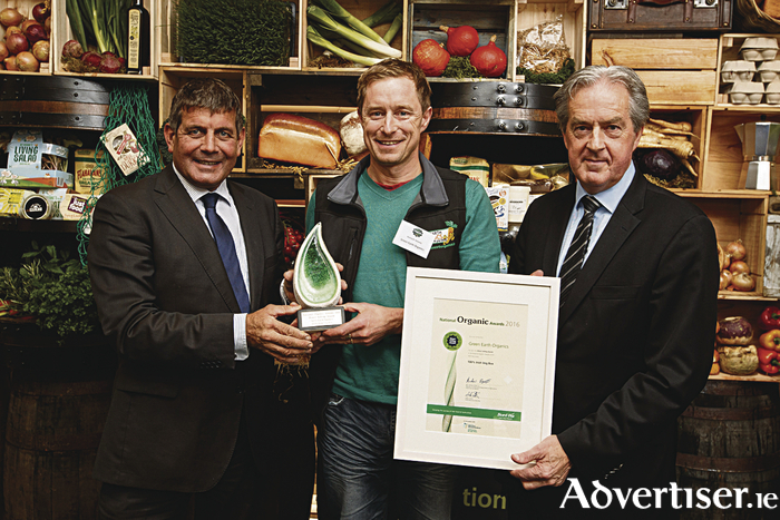 Kenneth Keavey from Green Earth Organics, winner of the Direct Selling Award for its 100% Irish Veg Box at the National Organic Awards 2016. The National Organic Awards, held in association with Bord Bia and the Department of Agriculture, Food and the Marine, mark the achievements of Irish organic food and drink growers and manufacturers who create excellent quality organic products in Ireland. For more information visit www.bordbia.ie. Kenneth is pictured with Andrew Doyle TD Minister of State at the Department of Food Forestry and Horticulture (left) and Aidan Cotter CEO Bord Bia. Picture Andres Poveda
