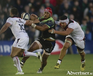 Connachts Bundee Aki is tackled by Jean Marc Doussain and Francois Cros of Toulouse in action from the opening game of the European Rugby Champions Cup in the Sportsground on Saturday. Photo:-Mike Shaughnessy