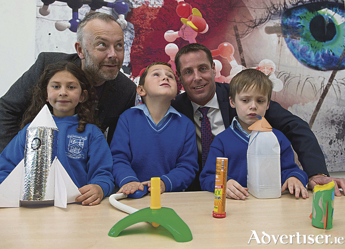 RTE 2FM presenter, Rick O'Shea and Ronan Rogers, Director of Research & Development, Medtronic Parkmore launch space rockets with 2nd class students from Scoil Chaitriona, Renmore, Galway at Medtronic Parkmore Customer Innovation Centre.  The Students were Maya Badreddine , Patryk Swierad and Fionn Casey from Scoil Caitriona Renmore Galway .  Photo: Andrew Downes,  xposure.