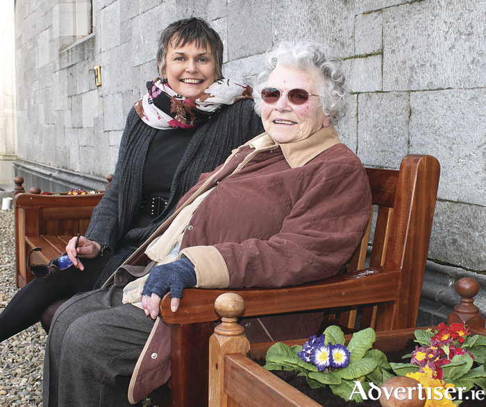 Anne Byrne who graduated from NUI Galway in 1936, pictured here in the Quadrangle with her daughter Úna Byrne, who graduated in 1976.
