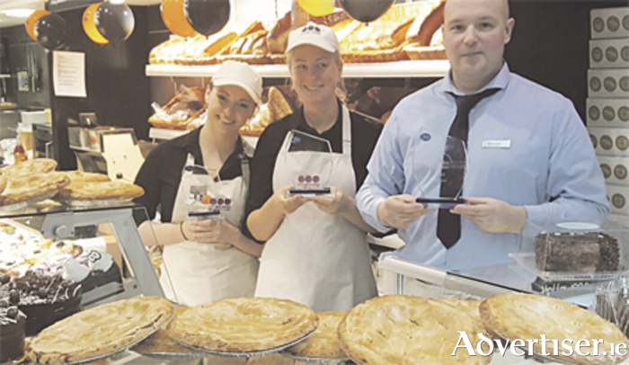 O'Hehirs staff proudly celebrating their National Food Awards in Athlone this week: (l-r) Priscilla O'Reilly, Elina Skribane, and Andrew Sedjukevich, manager