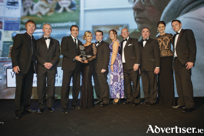 Best DIY & Agri Store 2016 Homeland Swinford manager, Lisa Doocey, accepts the Retail Excellence Ireland Award for DIY and Agri Store of the Year from Aidan Flynn. Also pictured are Hector O hEochagain (presenter); Jonathan Bowens; John McNulty; Miriam McDermott; Stanley Black; Joe McNulty; Evanne Ni Chuilinn (presenter); and James O Hara.