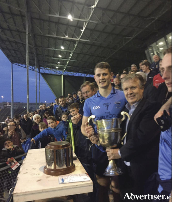 Westport captain Brian McDermott is presented with the Sweeney Cup. Photo: Mayo GAA