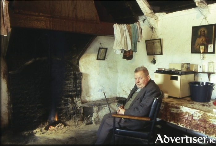 Tommy Cullen pictured at the hearth in the cottage.