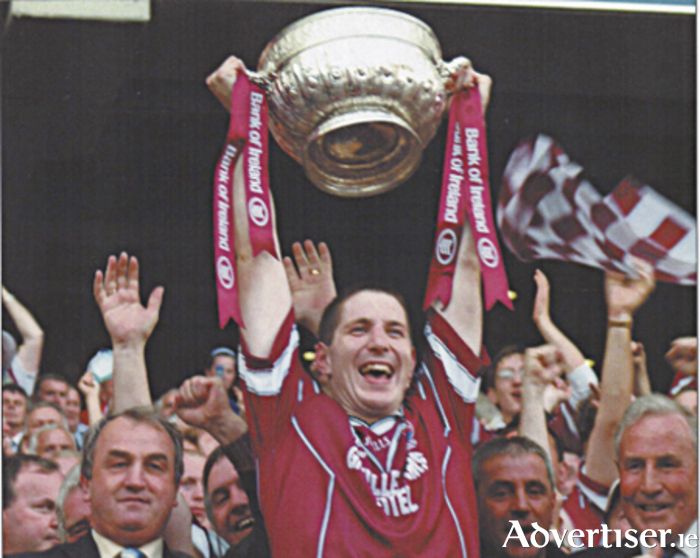 David O'Shaughnessy (Garrycastle) raising the Leinster Cup after Westmeath won their first Leinster senior title in 2004