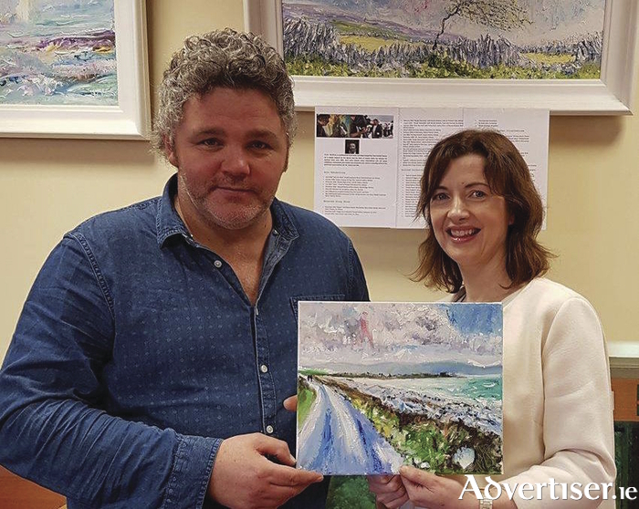 Artist Jim McKee with Siobhan Arkins of Ballybane Library.