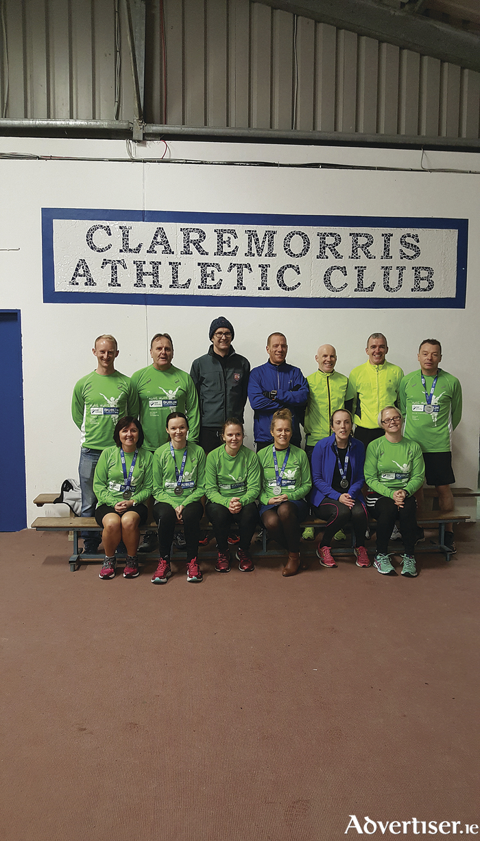 Mayo AC members from Claremorris who completed the Dublin City Marathon this year. Back Row: Timmy Ganley, Paul McLaughlin, Matt Bidwell (coach), Shane Timothy, Sean Murphy, Matthew Gill, Ger Fahy. Front Row: Geraldine Murphy, Caroline Allworthy, Erika Ryan, Mags Connell, Maria Kneasfy, Kelly Coyle. Missing from photo Tricia Carty and Helen Trench.