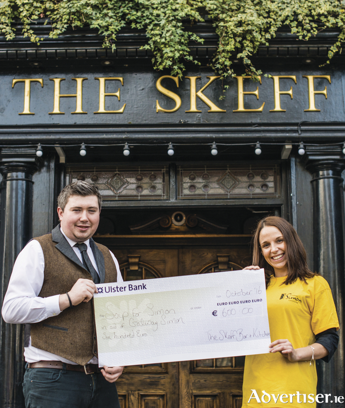 Amy Lavelle, Fundraising Manager, Galway Simon Community accepting a cheque for €600 from Jonathan Callaghan, Bar Supervisor, The Skeff Late Bar & Kitchen from the Soup for Simon campaign which took place in October.