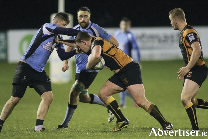 Buccaneers 'Ruairi Byrne charges at Galwegians, Ronan Moore in the Ulster Bank Rugby League division 1b clash at Dubarry Park on Friday night. Photo:-Mike Shaughnessy