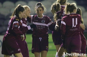 Galway WFC captain Meabh De Burca (second left) is congratulated by teammates after scoring the opening goal at Eamonn Deacy Park on Saturday night.   			Photo:-Mike Shaughnessy