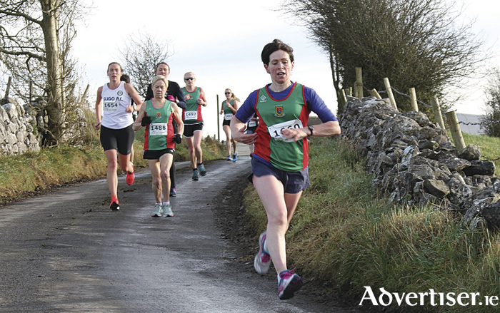 Noreen McManamon (Mayo AC) leads a group during the first lap of the women's 6k race at Hollymount Road Races.