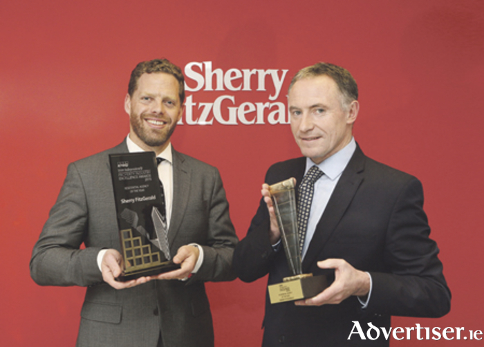 Michael Grehan and Ivan Gaine of Sherry FitzGerald pictured with the 2015 and 2016 awards