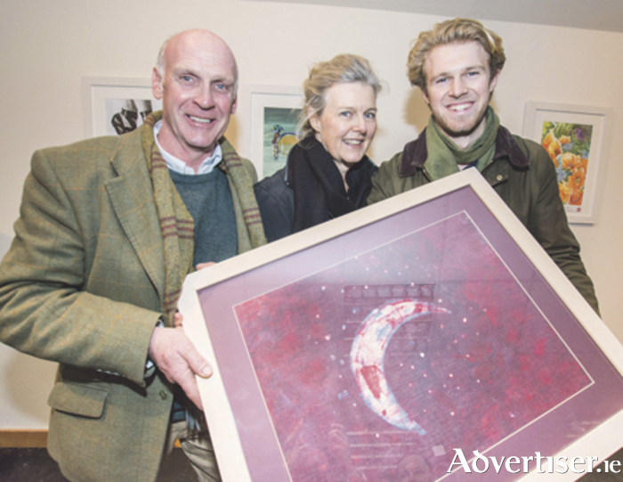 Monty Badger with his piece 'Au Clair De La Lune' is pictured at the ceremony with his father Trevor and mother Elizabeth.