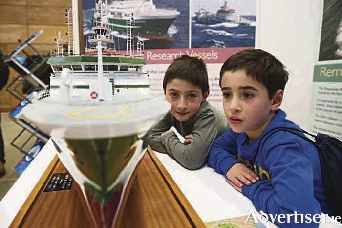 James and Simon Pereira  with a model of the Celtic Explorer in NUI Galway as part of the Galway Science & Technology Festival.  Photo: Andrew Downes, Xposure.
