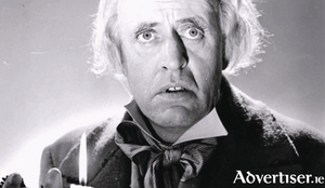 Alastair Sim as Scrooge.