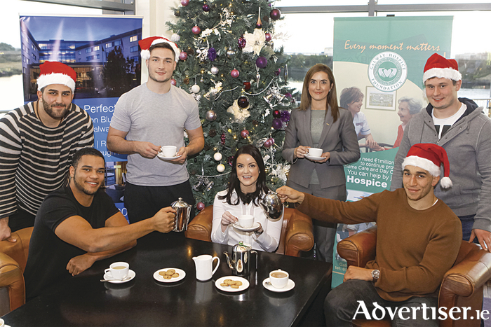 Connacht Rugby players are backing the Radisson Blu Hotel & Spa coffee morning for the Galway Hospice. Pictured front row, L-R: Cian Romaine, Joanne Tierney (Galway Hospice) and Ultan Dillane/ Back row, L-R: Saba Muenargia Connacht Rugby), James Connolly,  Roisin McGee (rooms division manager, Radisson Blu Hotel & Spa, Galway) and Ivan Soroka.