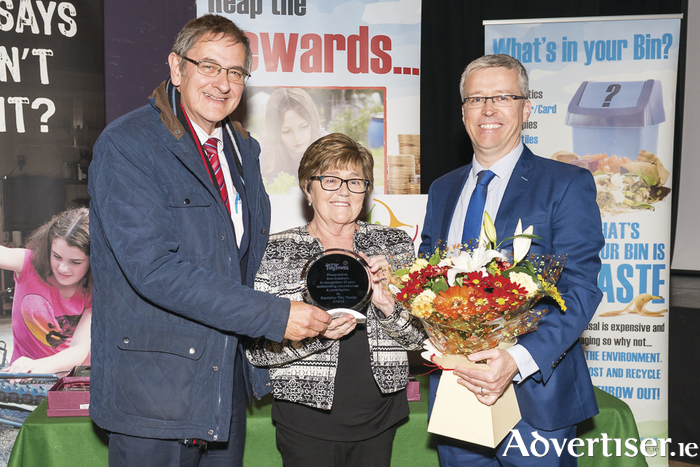 Ann Cresham receiving her outstanding contribution to volunteerism from Henry Kenny and Alan Mee, chairman, Castlebar Tidy Towns.