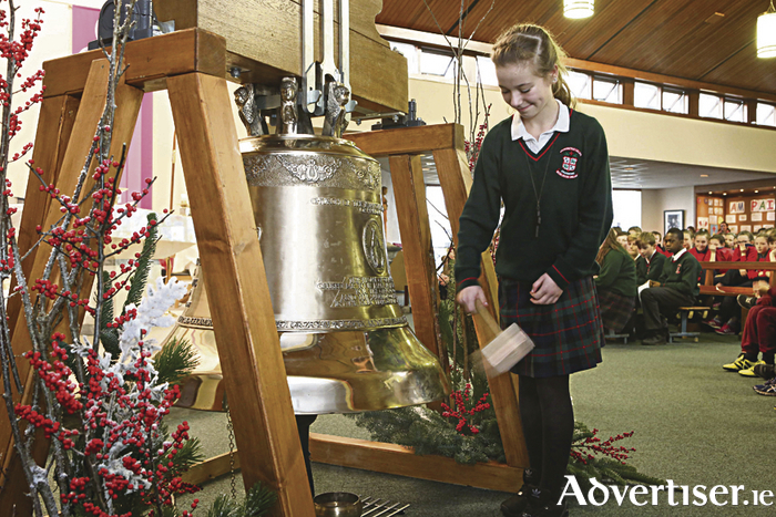 Calasanctius student Jane Luft was called forward to strike the newly blessed bell.