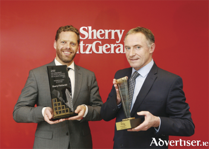 Michael Grehan (right), managing director of Sherry FitzGerald, receives the Residential Agency Award from Patrick Burke, managing director of Irish Life Investment Managers and patron of the DIT doctorate