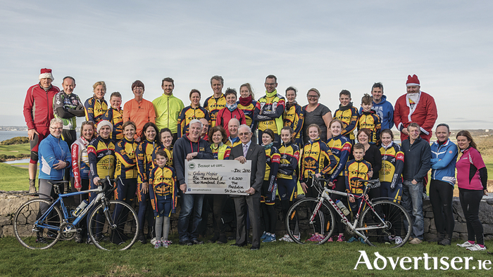 Picture Group : Predator Triathlon club presenting the cheque to Gerry Molloy on behalf of Galway Hospice. Holding cheque (from left) John Cloonan Predator club and Gerry Molloy Galway Hospice.