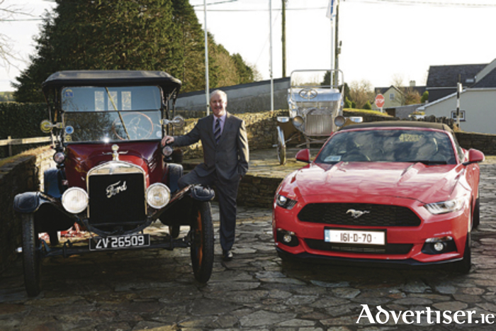 Pictured at the Ford family memorial in Henry Ford's ancestral village of Ballinascarthy, Co Cork, is Ford Ireland chairman and managing director Ciarán McMahon, with the 'old and new' of Ford: an original Model T and the new Ford Mustang which was launched for the first time in right-hand drive in Ireland during 2016.